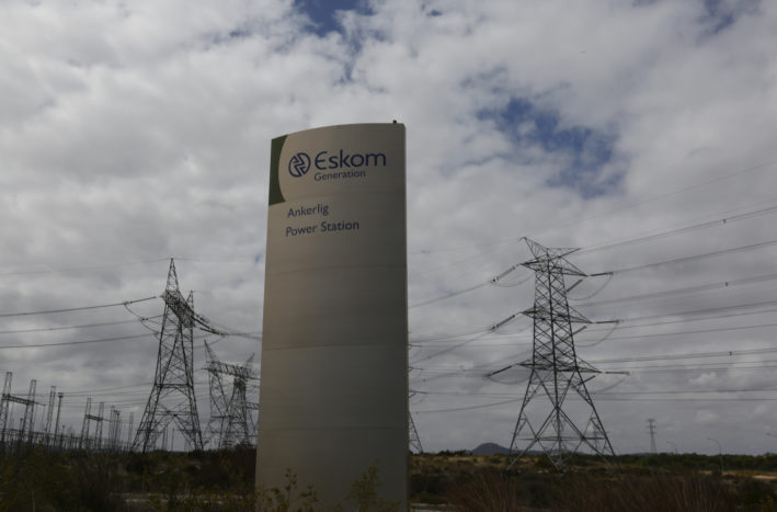 Pylons carry electricity from a sub-station of state power utility Eskom outside Cape Town in this picture taken March 20, 2016. REUTERS/Mike Hutchings - RTSBMS0