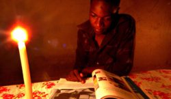Zimbabwean student Tawanda Moyo 15 years of Seke 2 Secondary School, in Harare doing his home work  at home using  candle light due to shortage of electricity which the country is facing.Zimbabwe now has the highest inflation rate in the world of 4000%