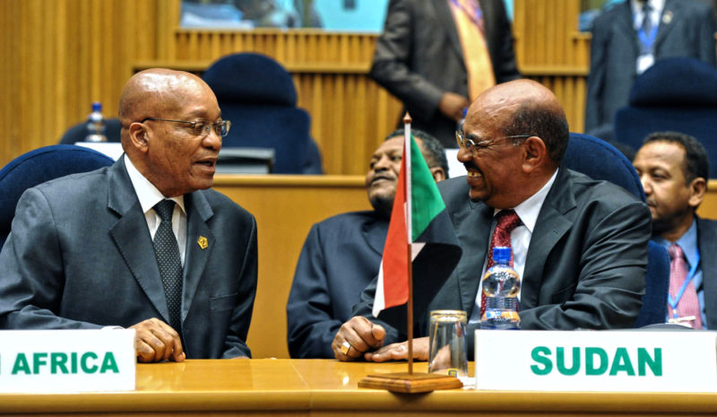 epa02554986 A photo provided by the South African Government Infomation Service shows South Africa's President Jacob Zuma (L) speaking to Sudanese President Omar al-Bashir (R) attending a session of the 24th African Union Summit of the NEPAD Heads of State/Government Orientation Committee (HSGOC) at the African Union Headquaters in Addis Ababa, Ethiopia, on 29 January 2011. The African Union agreed to set up a panel to help resolve Ivory Coast's political crisis, with its conclusions to be delivered within a month, a senior official said. EPA/Ntswe Mokoena / HANDOUT MANDATORY CREDIT EDITORIAL USE ONLY/NO SALES