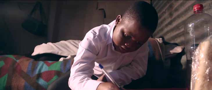 Emotional blackmail. A shot from the NSFAS advert in which a six-year old boy writes to beg NSFAS loan recipients to repay their loans so his sister can attend a tertiary institution.