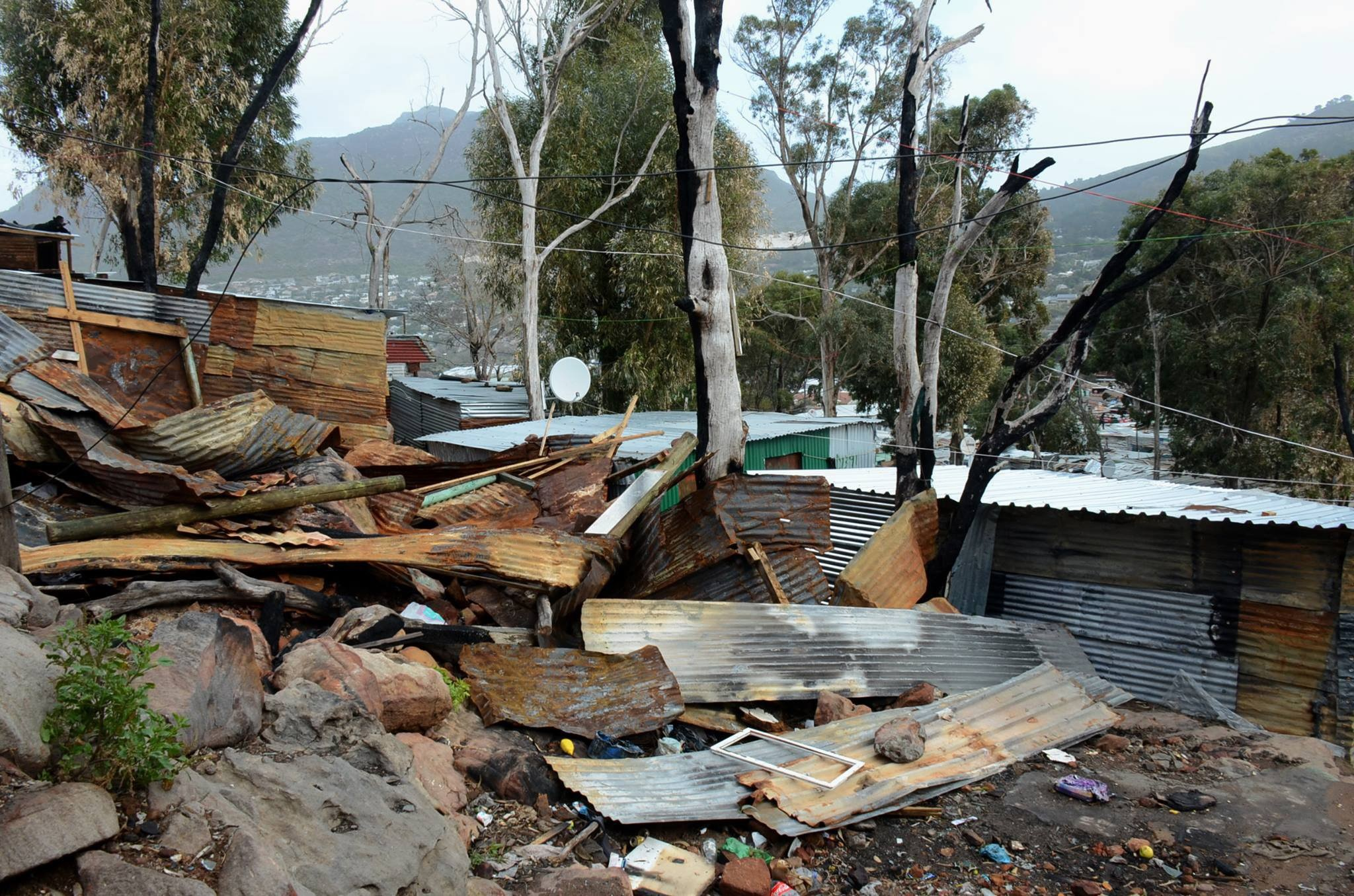 Hundreds of shacks were destroyed in Cape Town's recent storm. Climate change means that today's extreme weather will become the new norm.