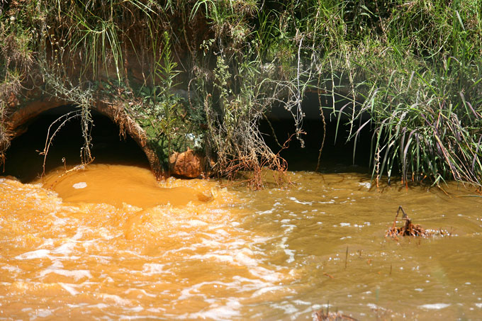 acid mine drainage Mine drainage is formed when pyrite, an iron sulfide, is exposed and reacts with  air and water to form sulfuric acid and dissolved iron some or all of this iron can .