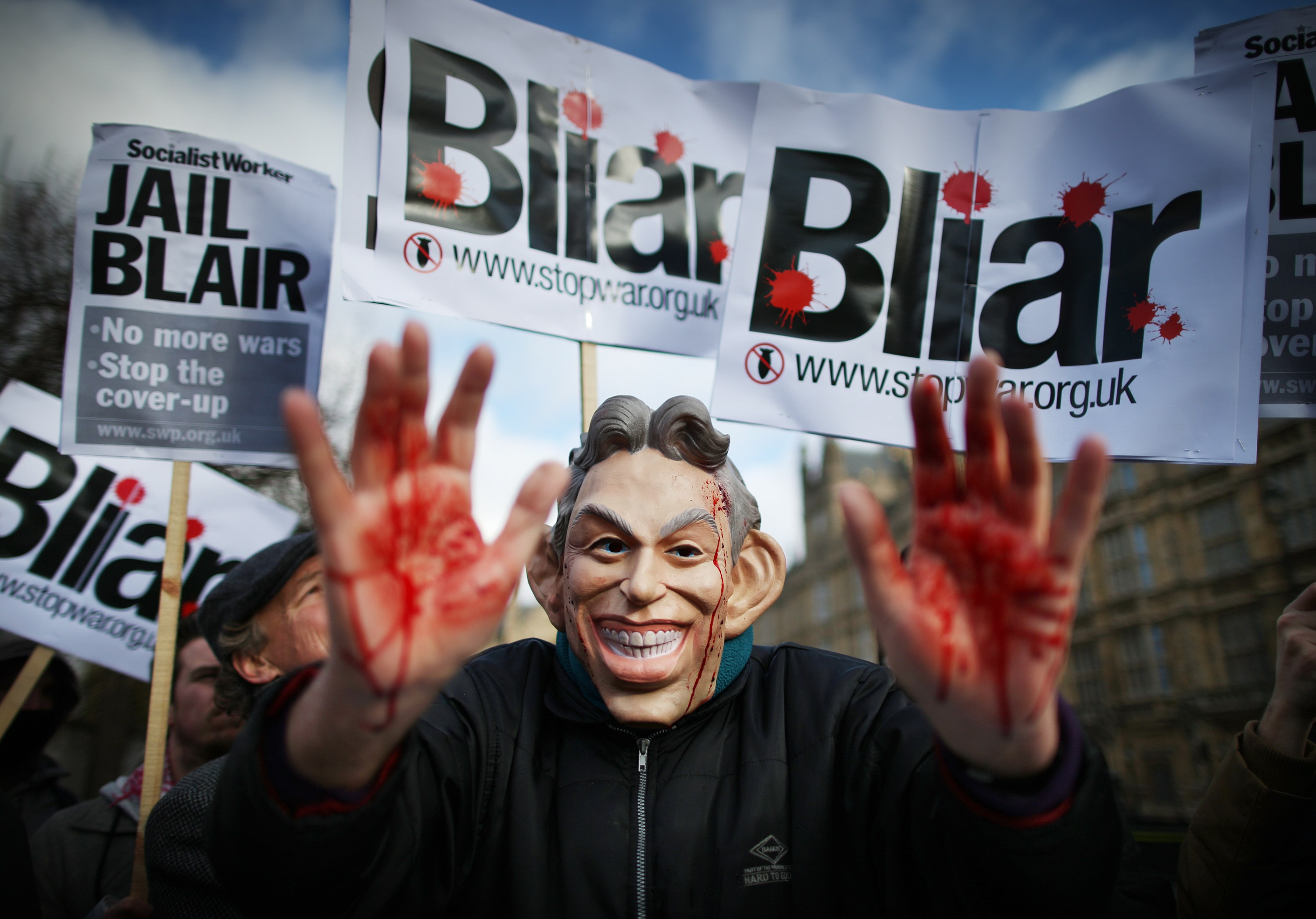 LONDON, ENGLAND - JANUARY 29: A Stop the War Coalition protestor, wearing a mask depicting Former Prime Minister Tony Blair, shows bloodied hands near Parliament on January 29, 2015 in London, England. Members of Parliament are today debating delays to the official inquiry into the Iraq War. The Chilcot inquiry began in 2009 and says it will not release it's final report until after the general election. (Photo by Peter Macdiarmid/Getty Images)