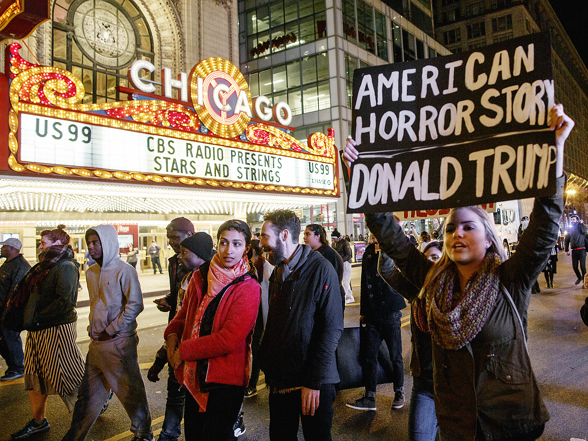 CHICAGO, IL - NOVEMBER 09: Demonstrators protest outside the Chicago Theatre November 9, 2016 in Chicago, Illinois. Thousands of people across the United States took to the streets in protest a day after Republican Donald Trump was elected president, defeating Democrat Hillary Clinton. (Photo by John Gress/Getty Images)