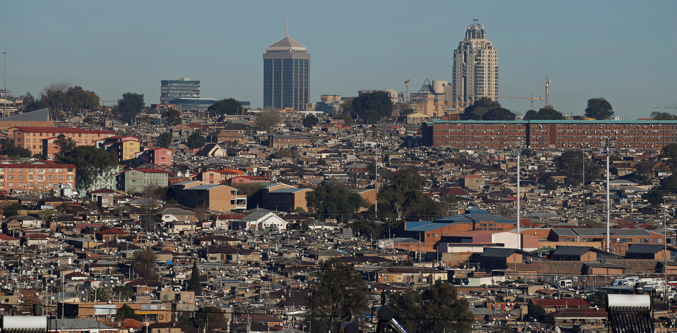 A general view shows Alexandra Township, an informal settlement for thousands of South Africans who lack the means to get a proper home, located near the upper-class suburb of Sandton in Johannesburg, South Africa July 28, 2016. Picture taken July 28, 2016. REUTERS/Siphiwe Sibeko - RTSKAJ0